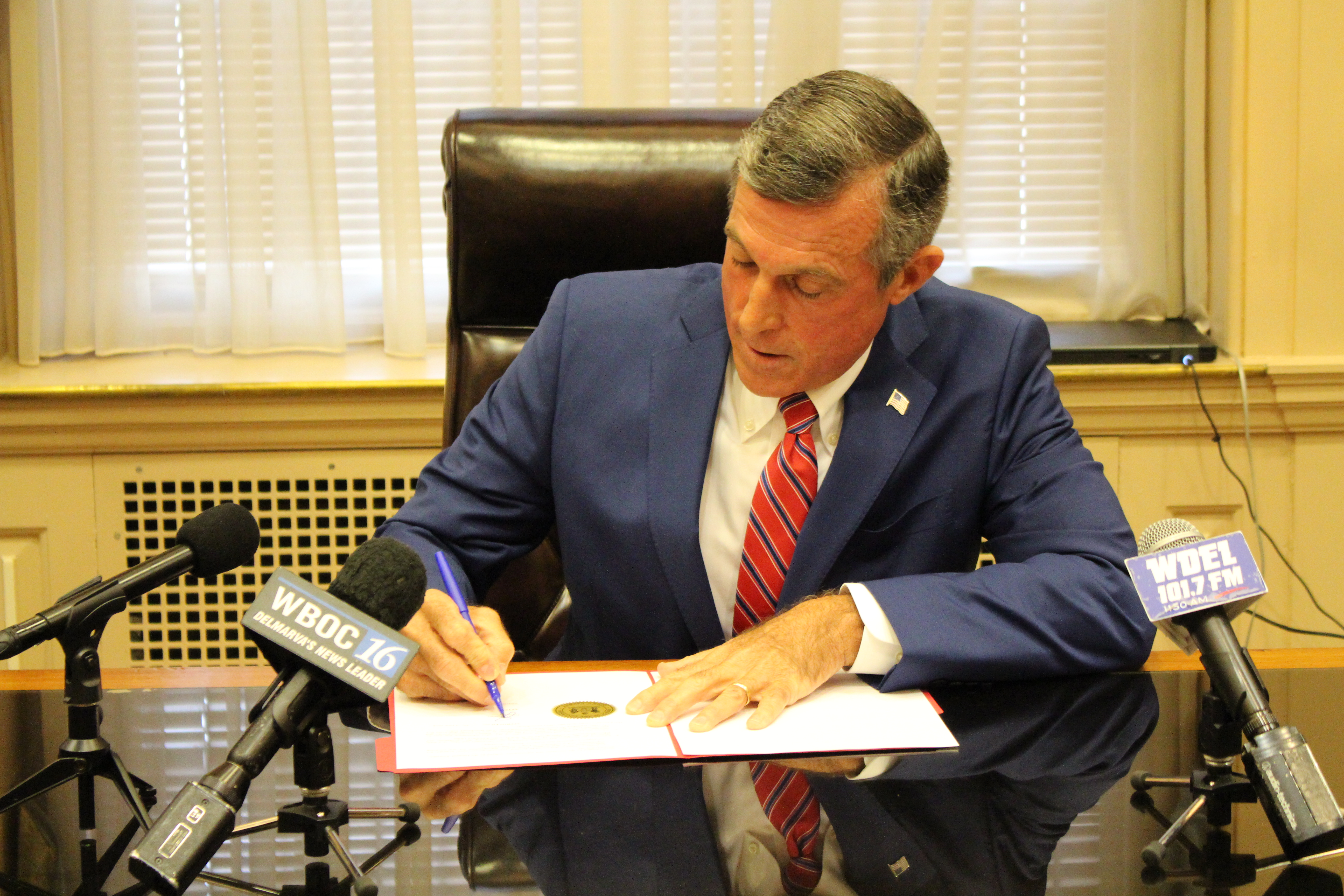 Governor Carney signs Executive Order on Budget Smoothing