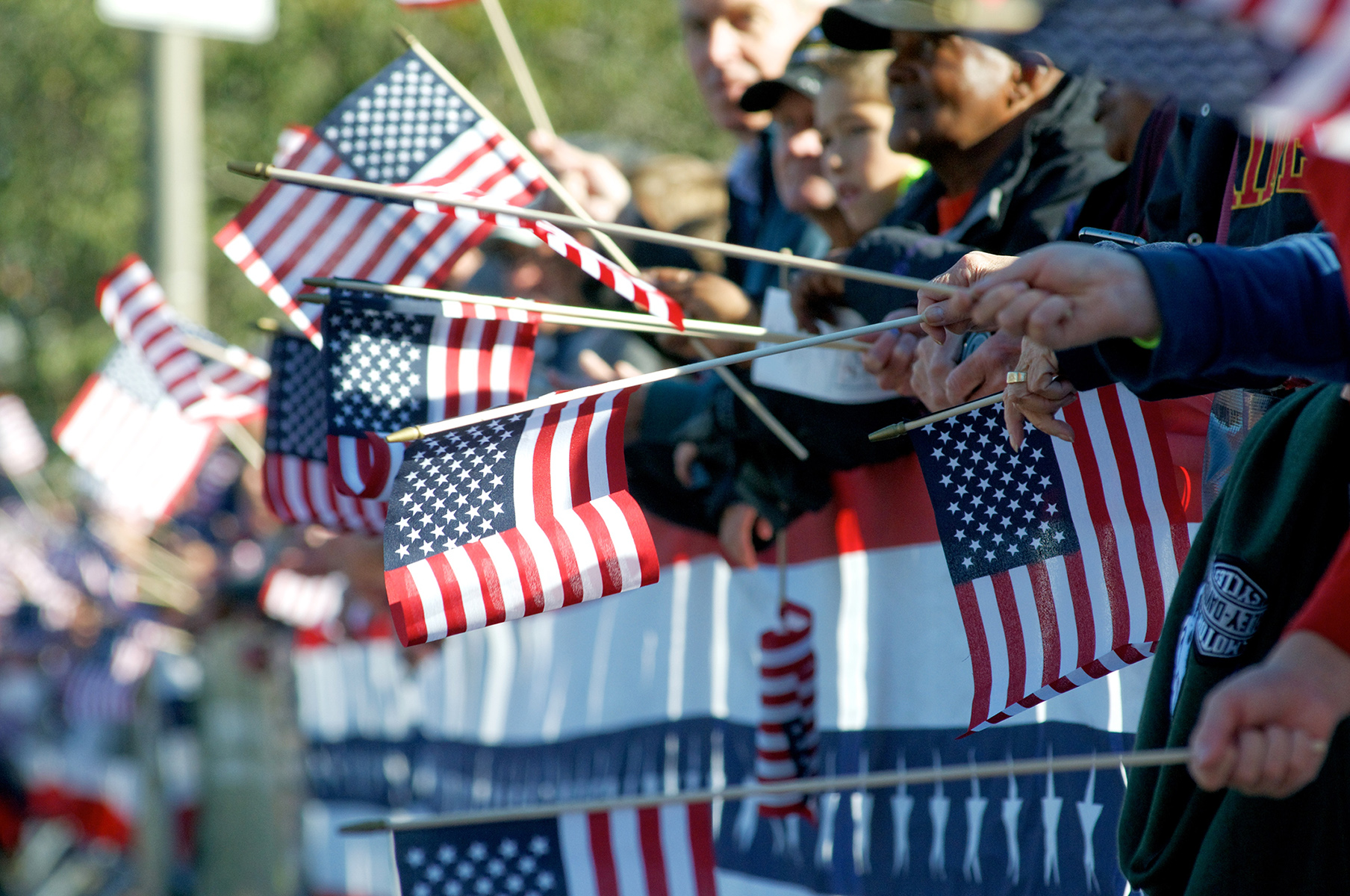 Photo of American Flags and Parade goers
