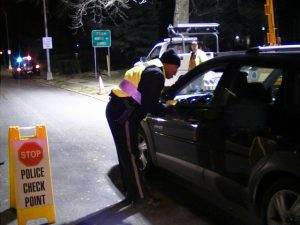 police officer working DUI checkpoint in Dover Delaware