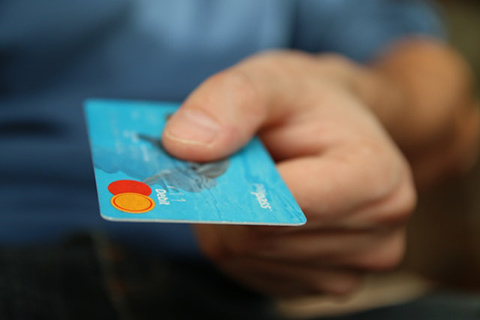 Photo person holding debit card