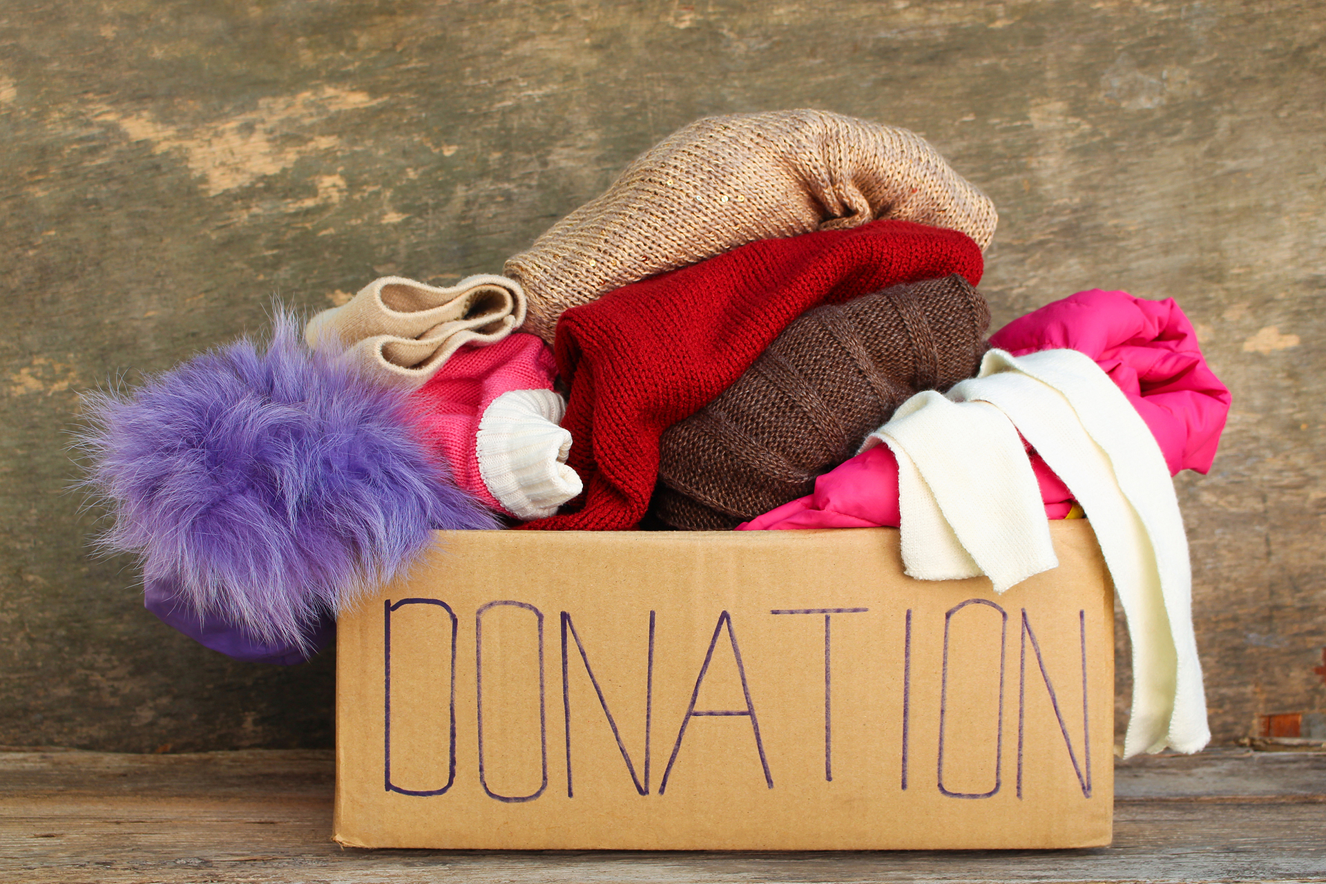 Image of a donation box with cold weather clothing inside