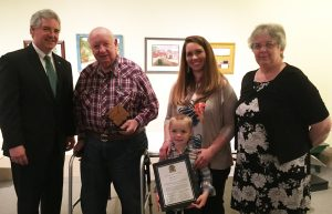 DNREC Secretary Shawn M. Garvin congratulates Kent County Agricultural Award honoree Alfred Moor Jr. of Smyrna, with his granddaughter-in-law Hallie Moor, great-grandson Everett Moor, and Gail Montgomery.