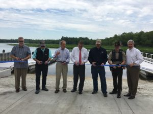 Cutting the ribbon at DNREC's new boat ramp at Phillips Landing near Laurel were, left to right: State Representative Timothy Dukes, State Rep. Daniel Short, US Senator Tom Carper, State Senator Bryant Richardson, DNREC Division of Fish & Wildlife Construction Manager Jeremey Ashe, Fish & Wildlife Natural Resources Police Chief Drew Aydelotte, and DNREC Secretary Shawn M. Garvin..