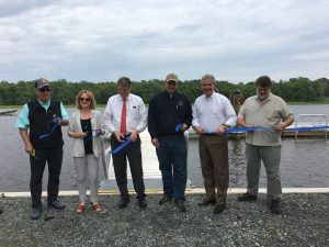 Cutting the ribbon at the new Woodland Wharf Boat Dock and Kayak Launch near Laurel were, left to right: State Rep. Daniel Short, Jessica Hammond of the Chesapeake Conservancy, State Senator Bryant Richardson, DNREC Division of Fish & Wildlife Construction Manager Jeremey Ashe, DNREC Secretary Shawn M. Garvin, and Planning and Development Manager Bob Campbell, National Parks Service, Chesapeake Bay Office.