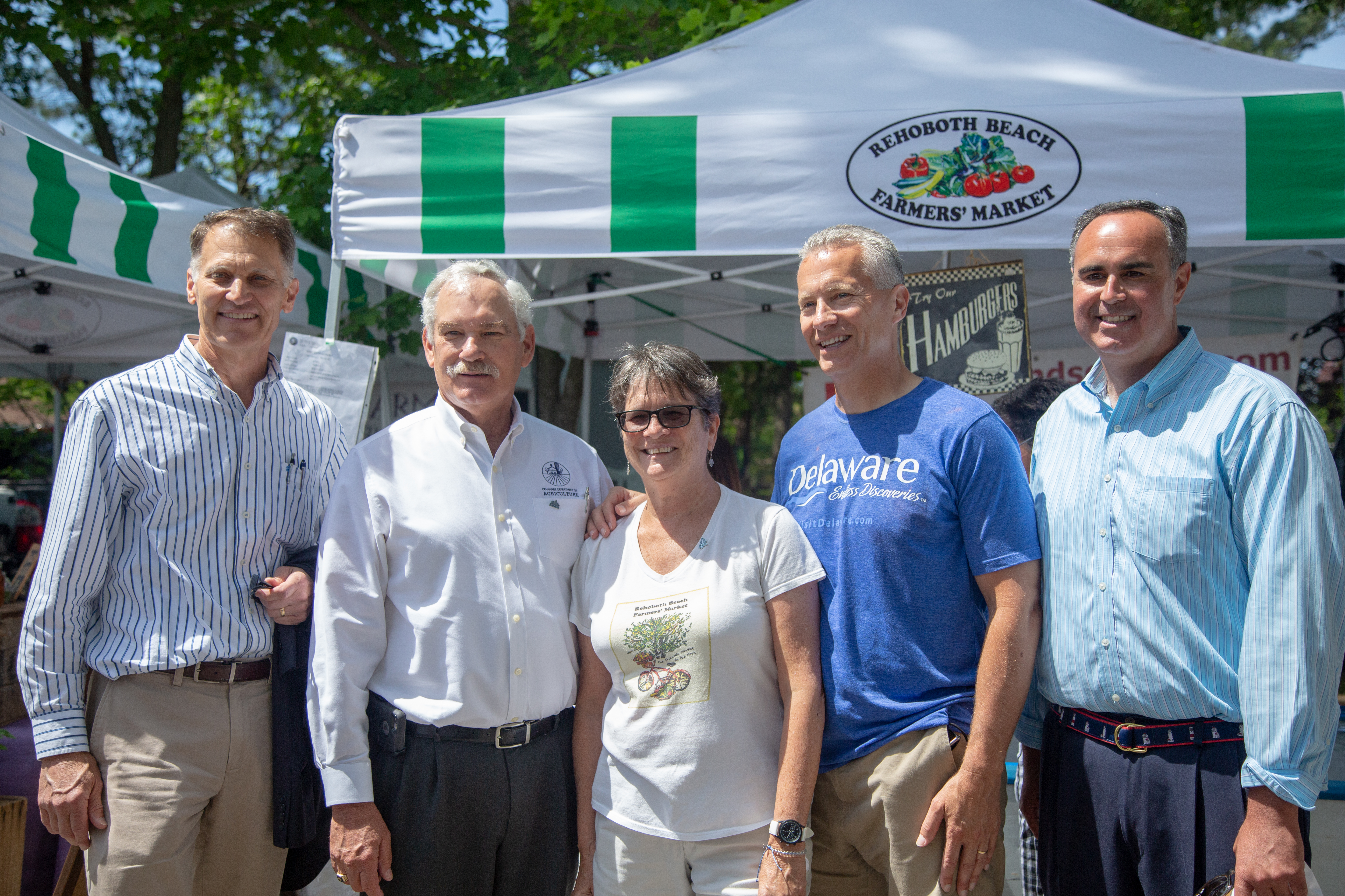 Secretary of Agriculture Michael T. Scuse and Rehoboth Farmers' Market Manager Pat Coluzzi are joined by state legislators to kick off Delaware Grown Week.