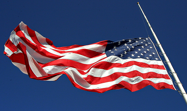 Photo of American flag flying at half mast