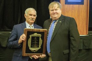 Delaware Secretary of Agriculture Michael Scuse presents award to Dr. Richard Barczewski