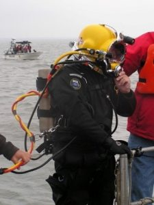 Photo of a diver returning from an archaeological investigation of the Roosevelt Inlet Shipwreck site in Delaware Bay on Oct. 11, 2006.