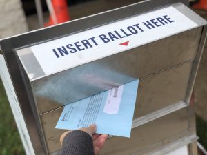 Drop your voted ballot in the ballot drop box.