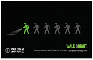 Walk Bright pedestrian safety creative demonstrating walking bright at night with a flashlight and bright clothing in English
