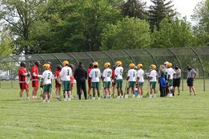 In this photo, Ferris School and Polytech players and coaches get ready for their game in May.