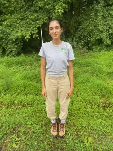 Tick Biological Aide Sierra Quiles, demonstrating tick-safe attire: light-colored clothing and pants tucked into socks. DNREC photos.