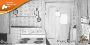 black and white photograph of an old unused kitchen with a vintage electric stove in front of a wall with tiles on the bottom half and wallpaper on the upper half next to a door