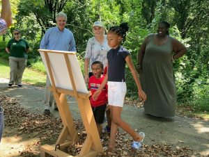 Two children look at the Story Walk installation at Brandywine Park.
